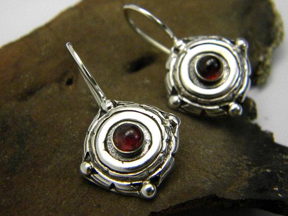 Small silver earrings, garnet stone