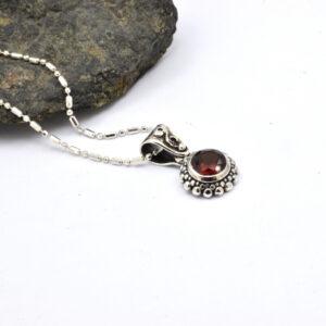 Sterling silver small garnet pendant